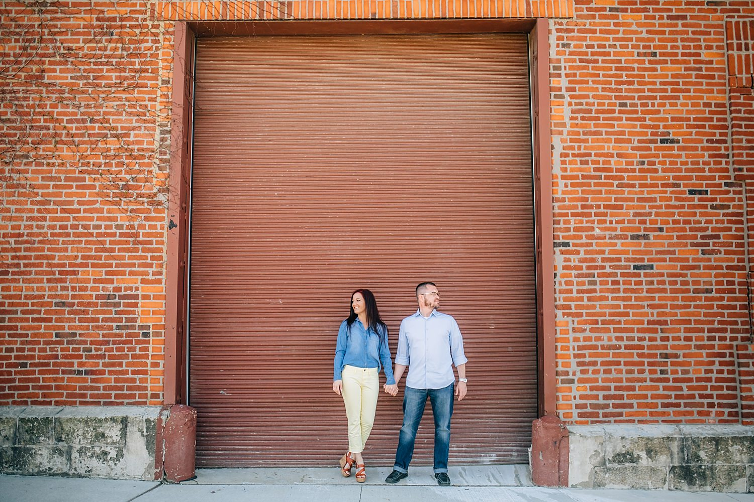 engaged couple poses for engagement photos downtown columbus ohio