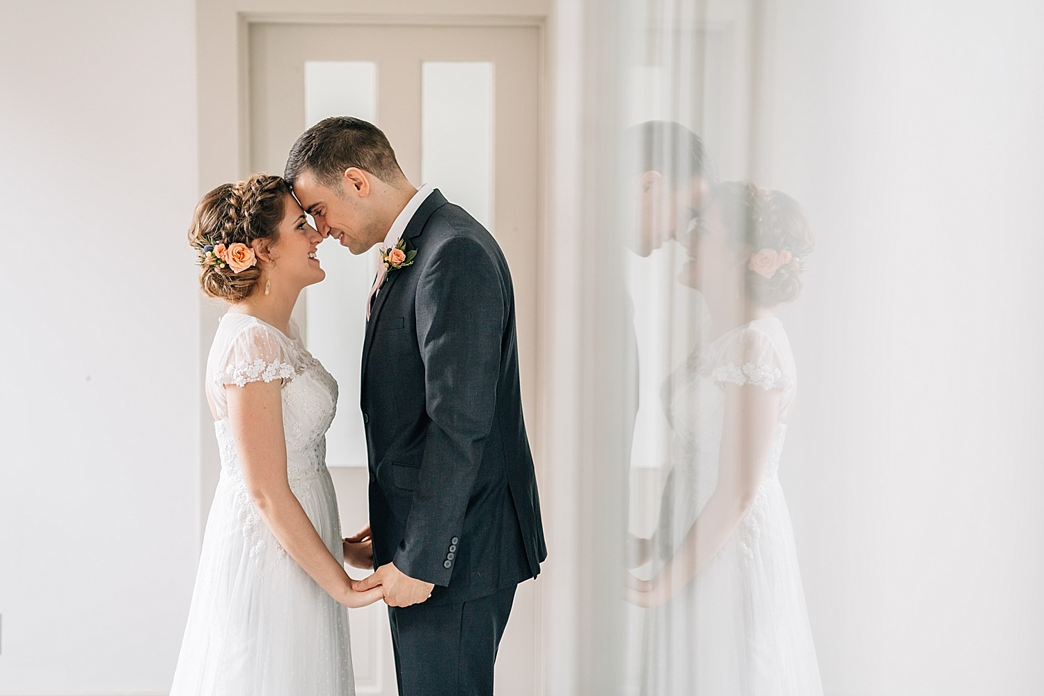 bride and groom during first look at clay media group in delaware ohio