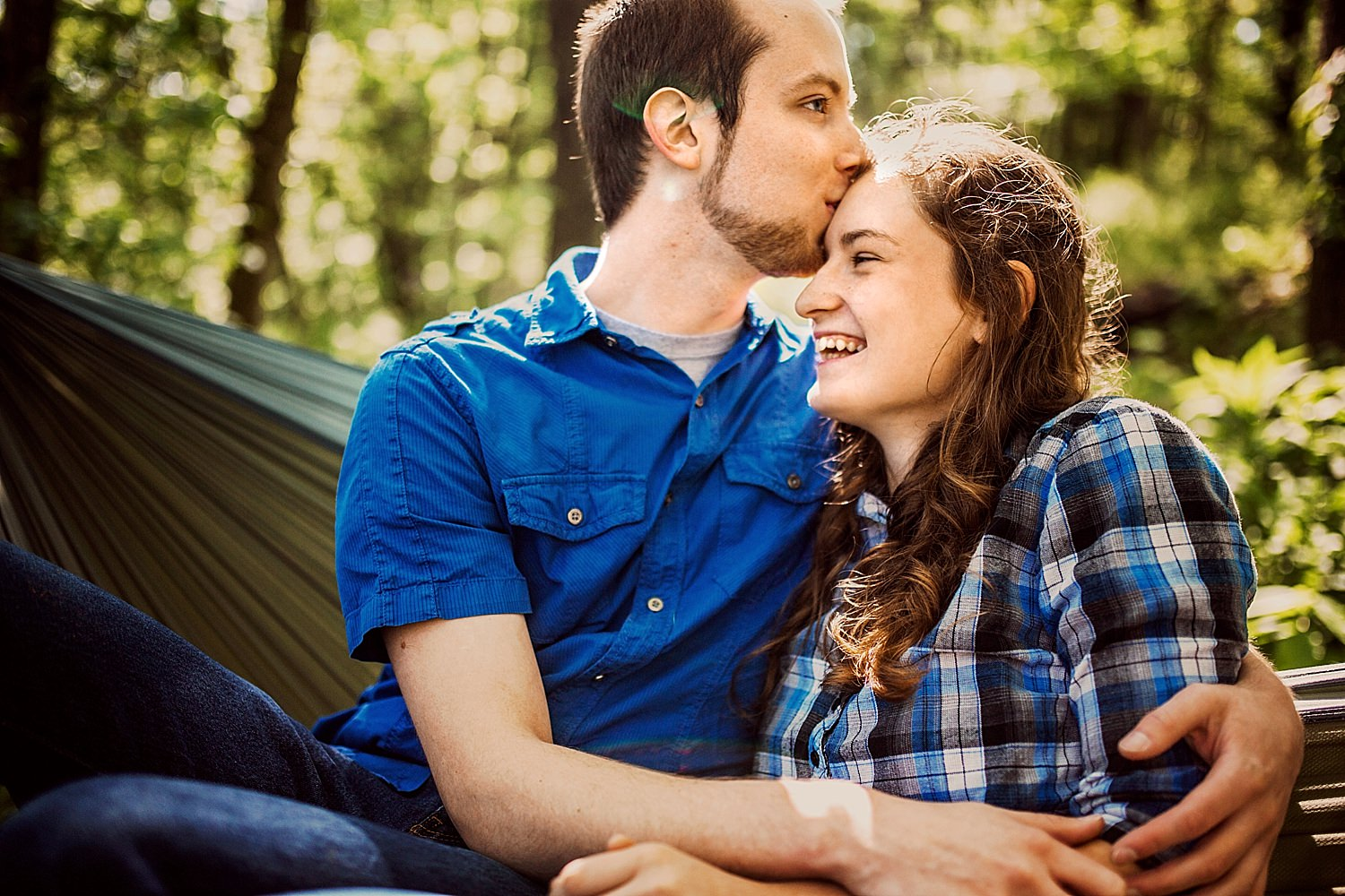 outdoorsy engagement photos taken in creek with hammock