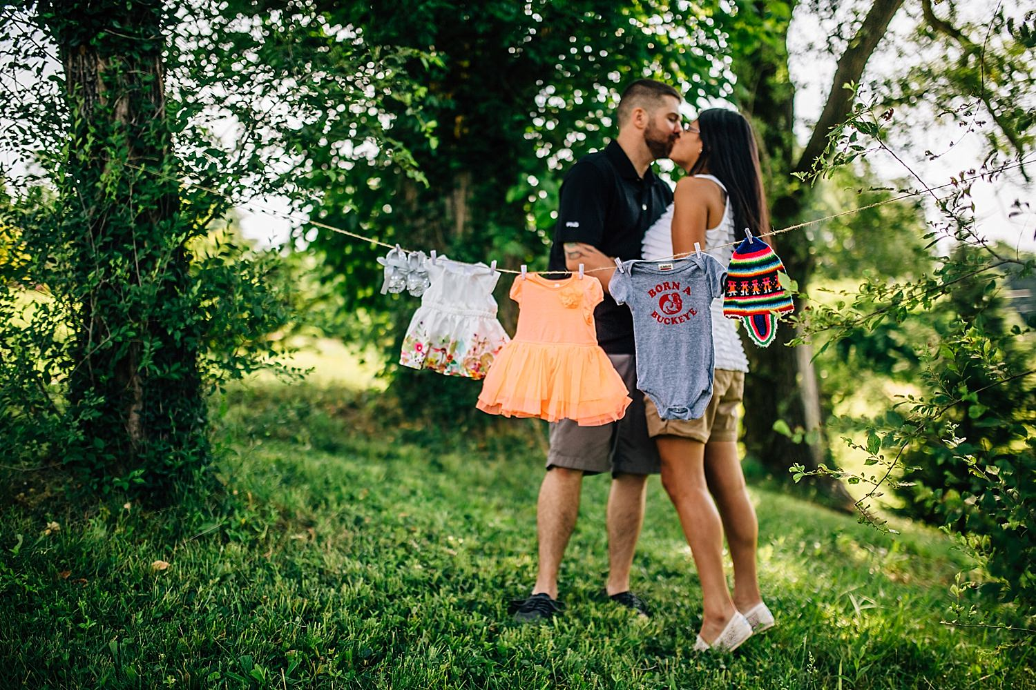 couple announces their pregnancy with outdoor maternity photos