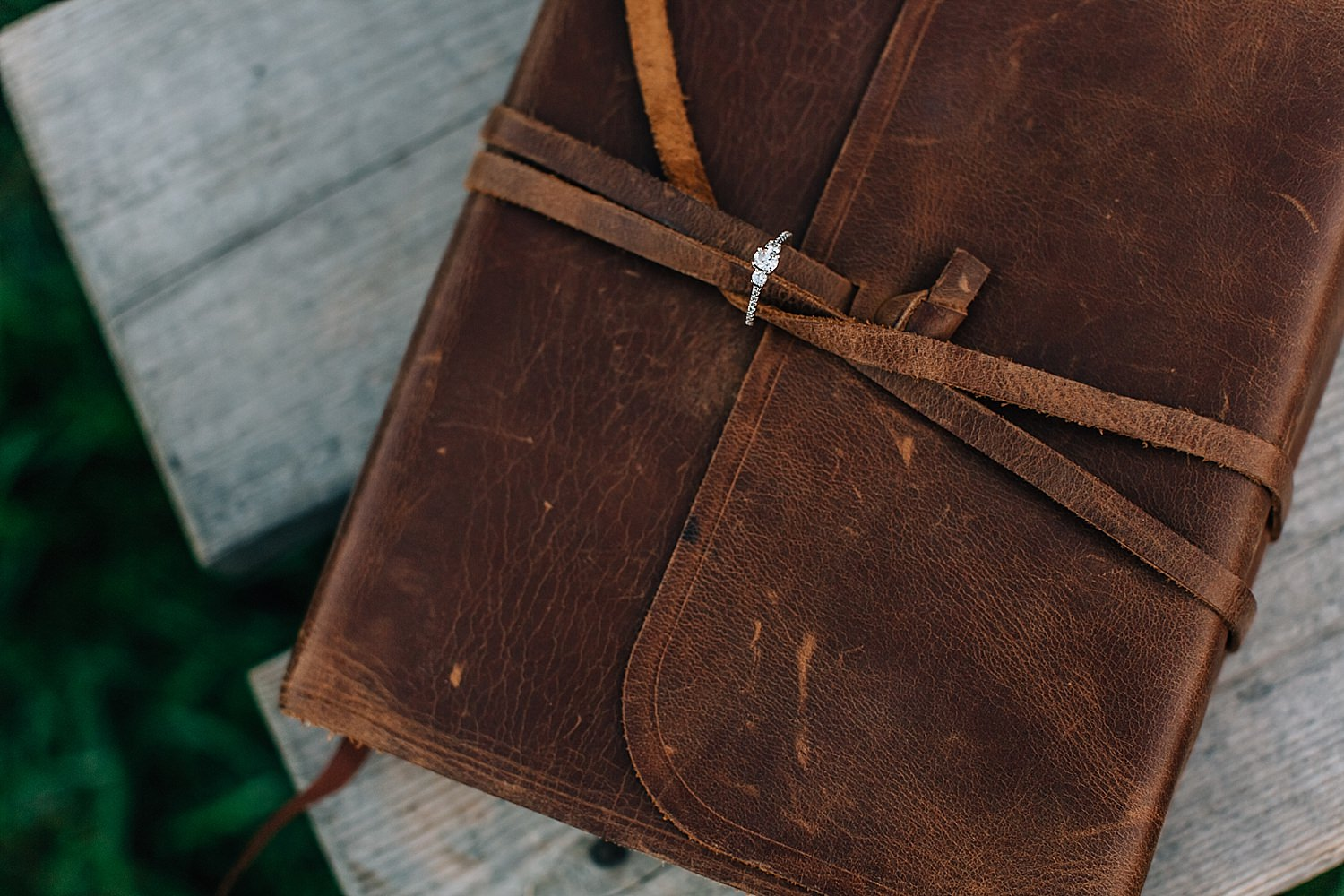 outdoor engagedment photos during golden hour in newark ohio with bible