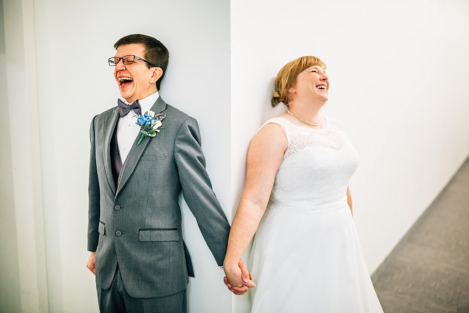 bride and groom laugh during first look at church wedding in delaware ohio