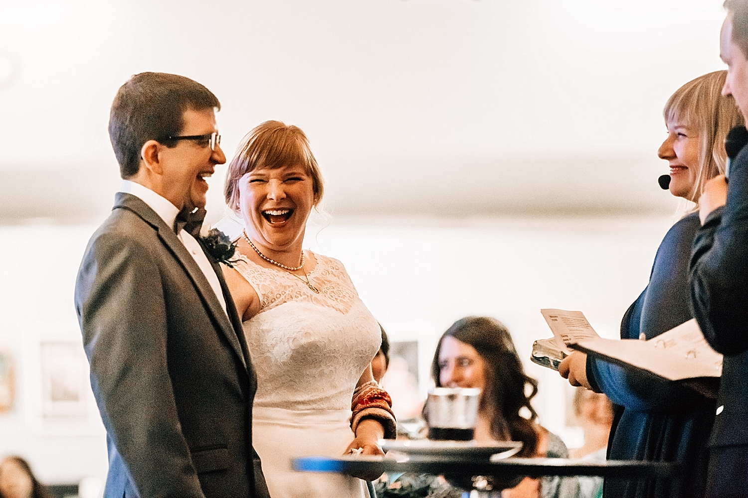 bride and groom laugh during ceremony in church wedding in delaware ohio