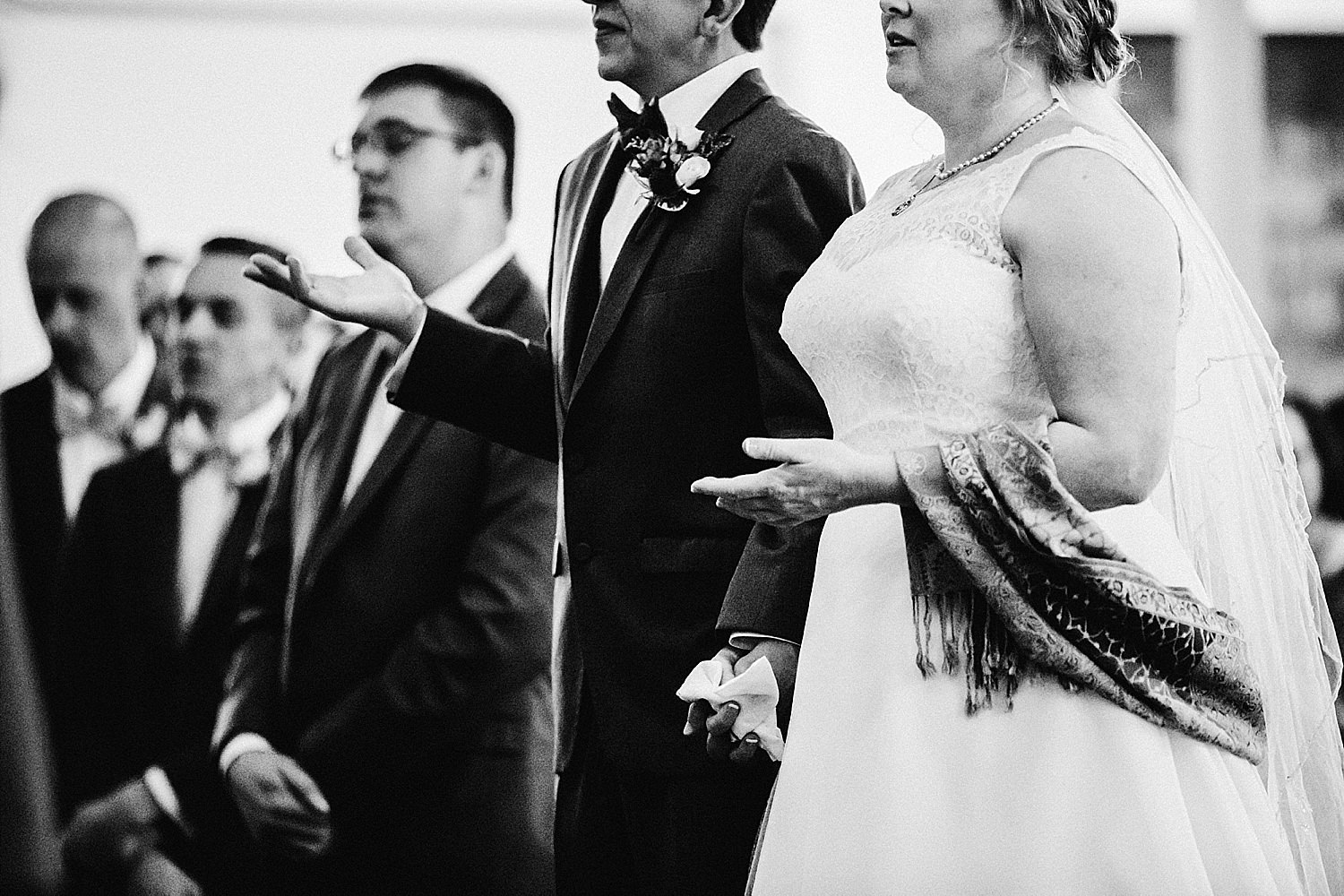 bride and groom sing and praying during ceremony of church wedding in delaware ohio