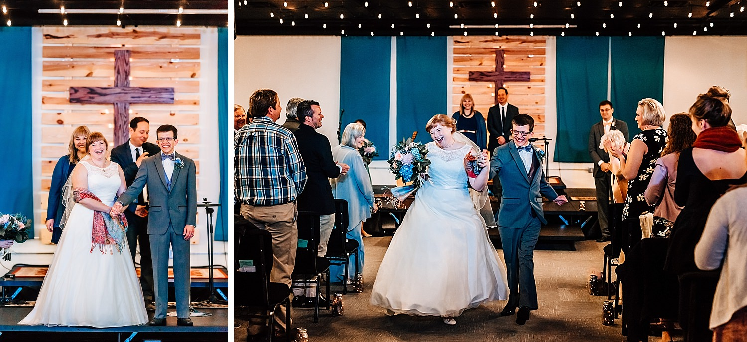 bride and groom dance down the aisle after being announced during ceremony of church wedding in delaware ohio