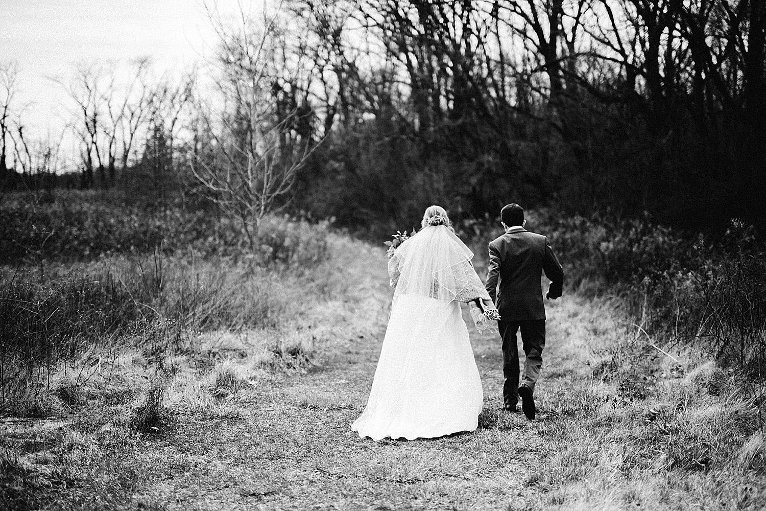 black and white bride and groom photos in field at gallant wood in delaware ohio