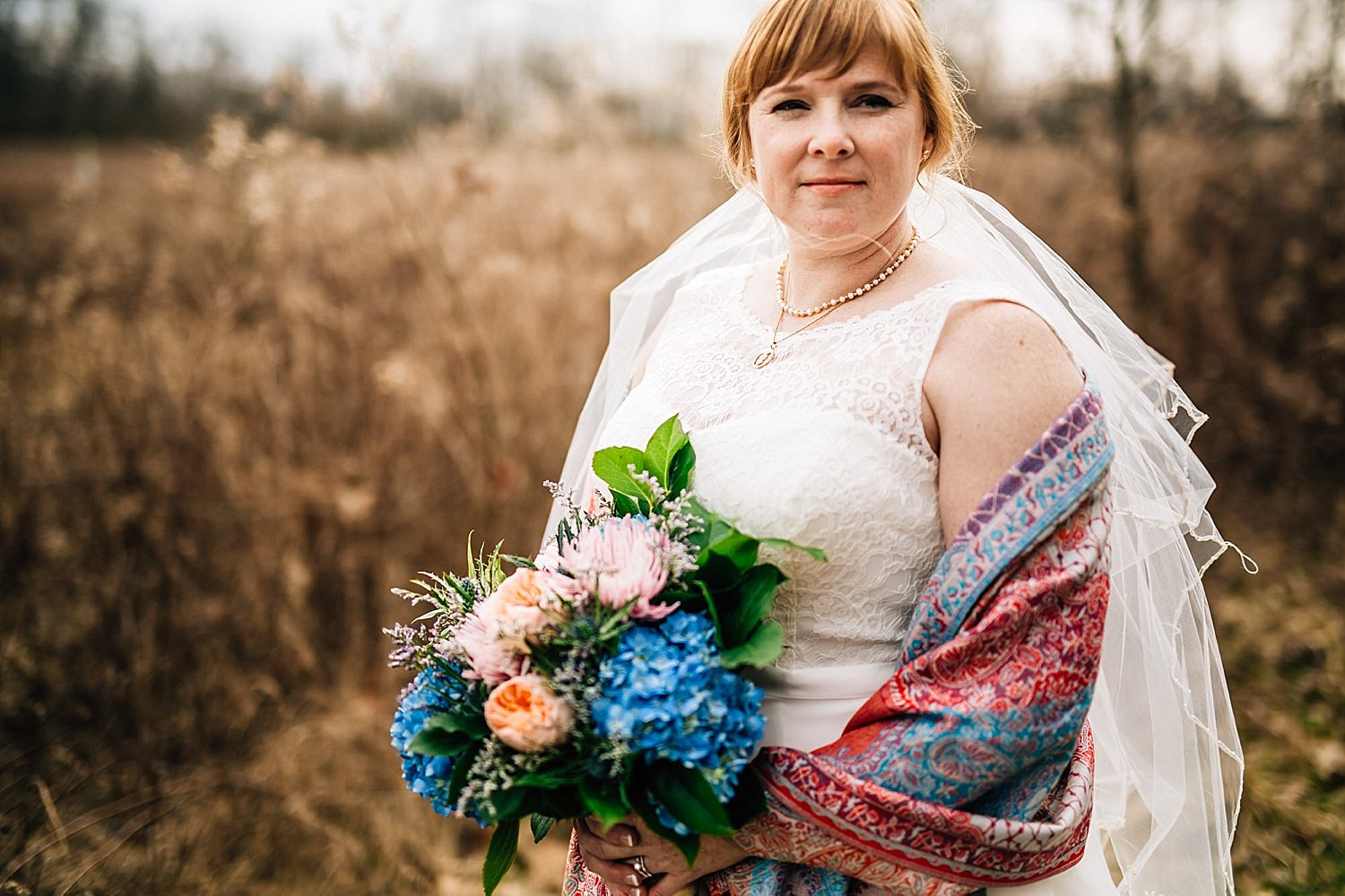 bride and groom photos in field at gallant wood in delaware ohio