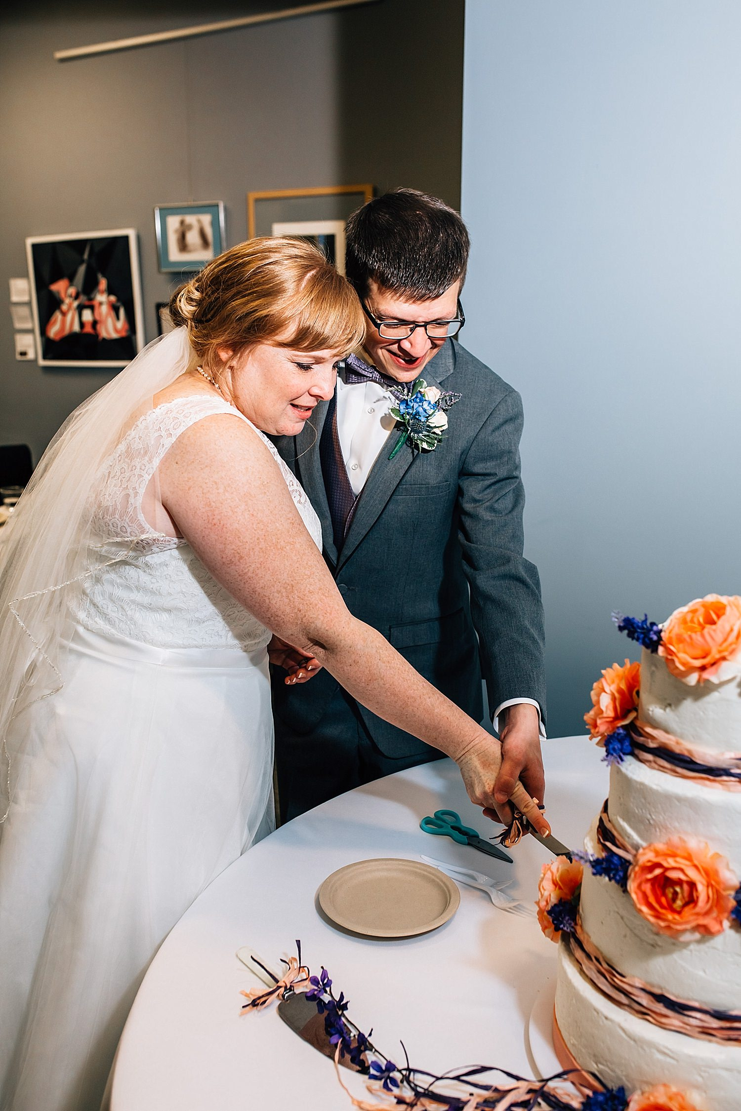 cutting the cake during reception of church wedding in delaware ohio