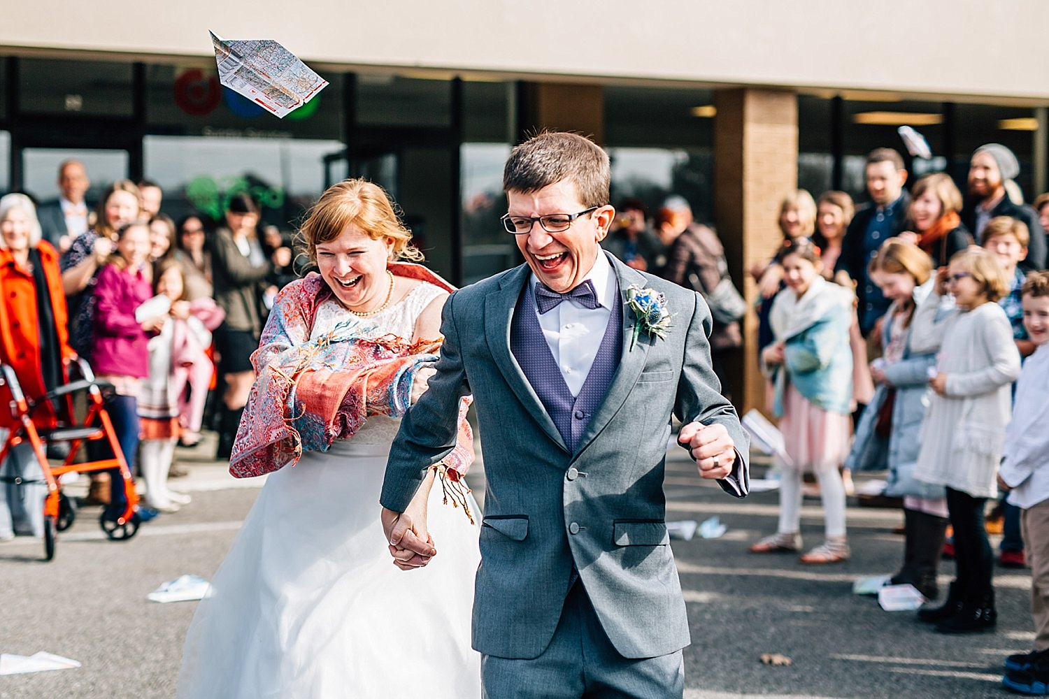 bride and groom send off with paper airplanes after reception of church wedding in delaware ohio