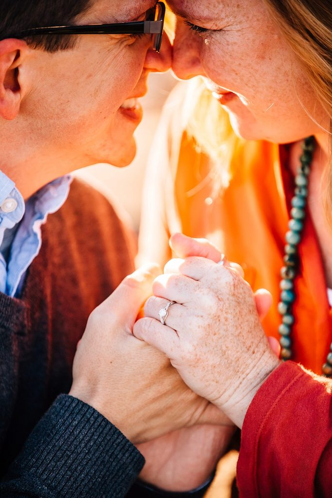 engaged couple holding hands outside showing ring in westerville ohio