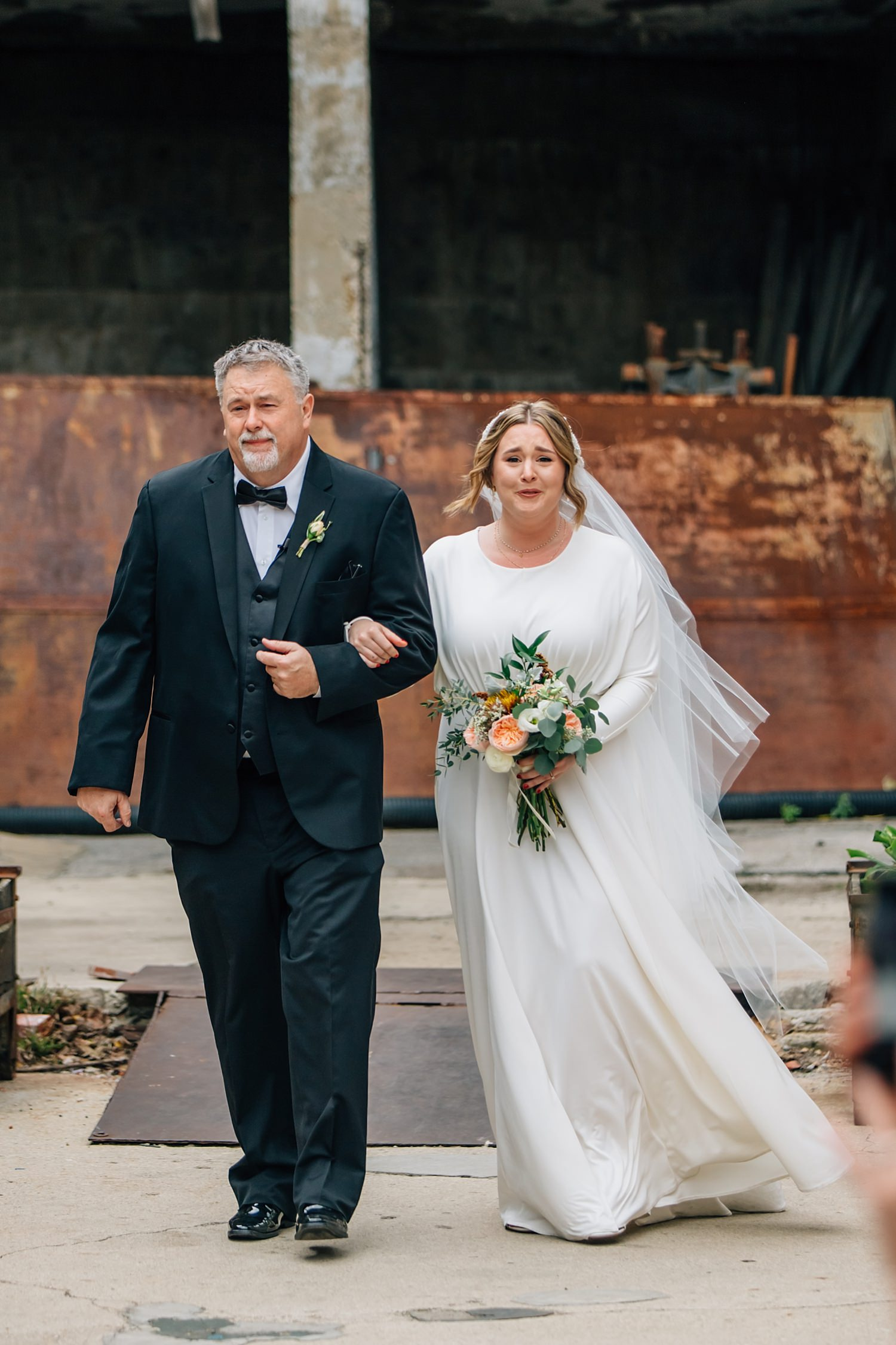bride and father of the bride walking up aisle during ceremony