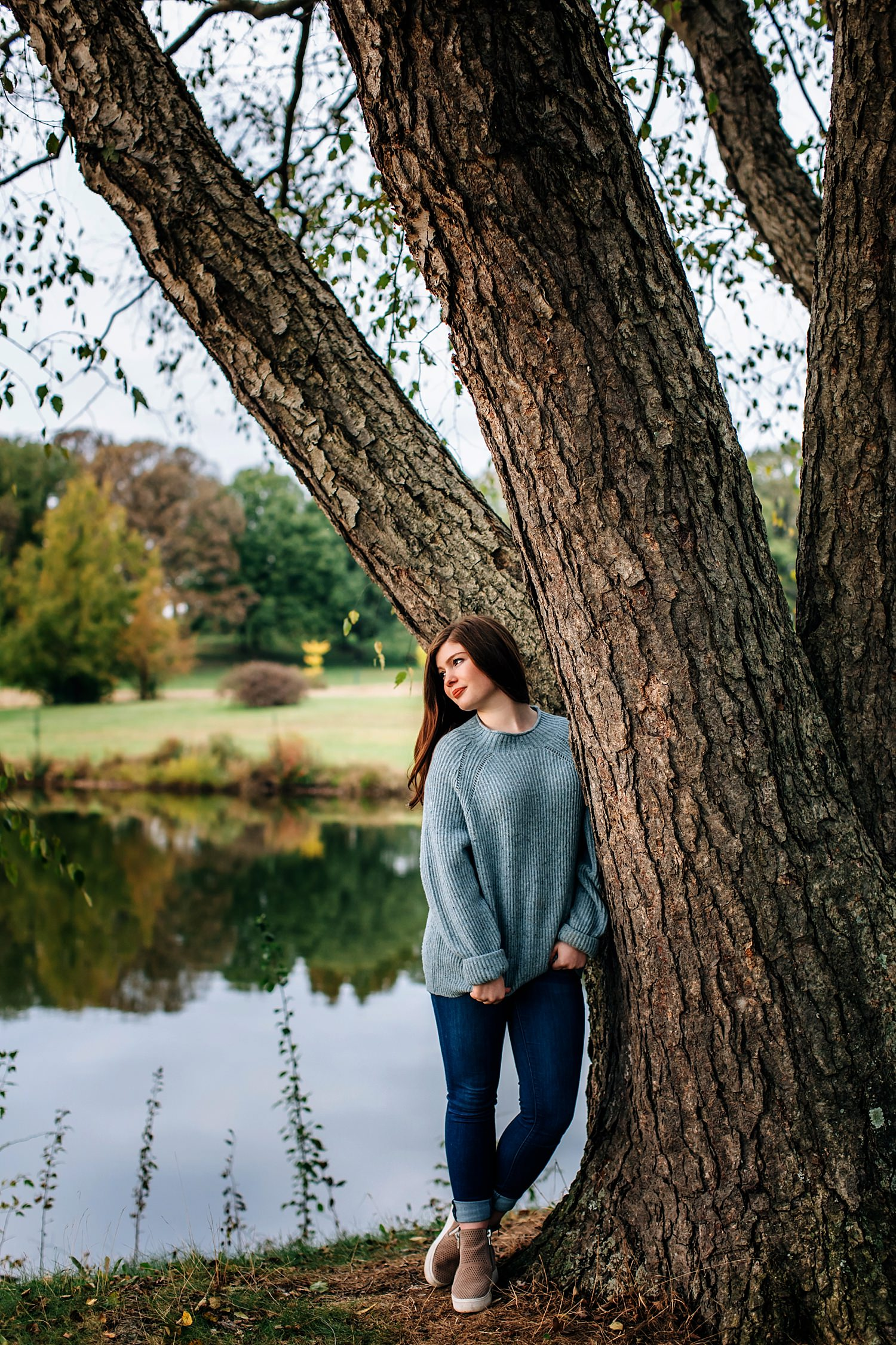 senior portrait of girl leaning against tree in granville ohio