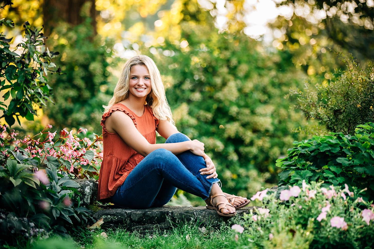 senior portrait girl sitting on step in garden in granville ohio