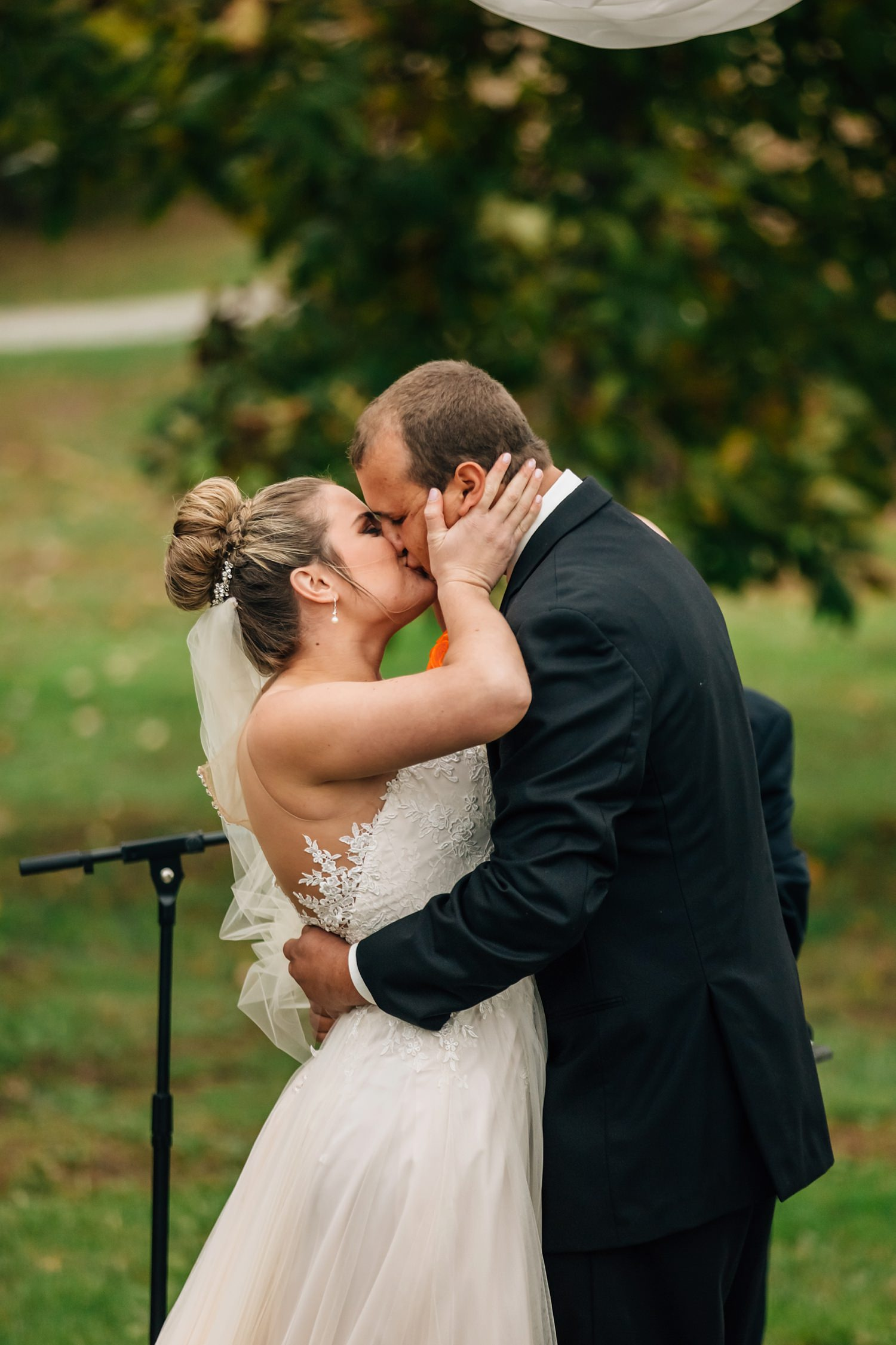 first kiss during small wedding ceremony in johnstown ohio